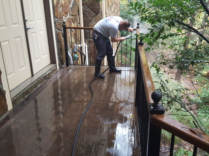 Attention to detail on a wood deck cleaning job.