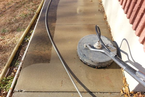 During a concrete cleaning job. Dirty to like-new.