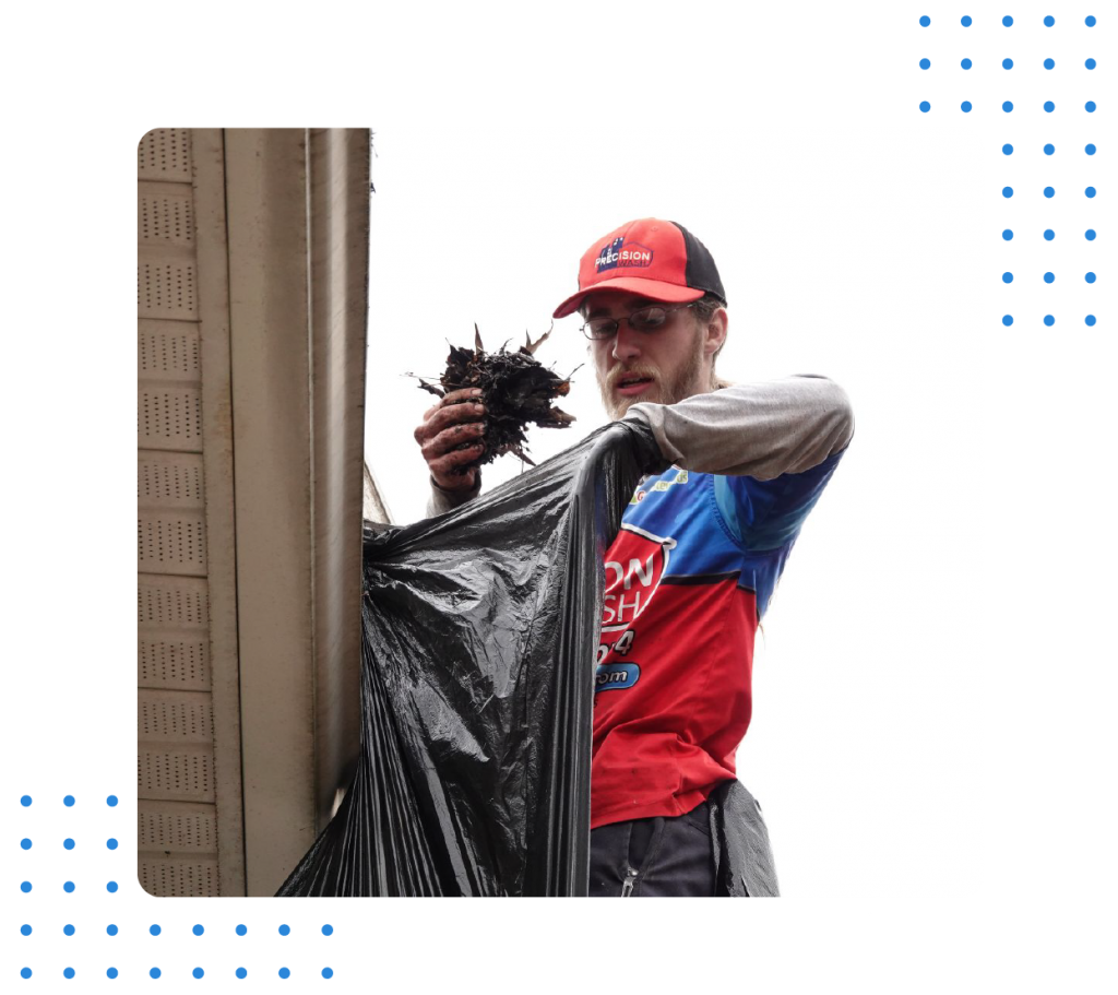Cleaning gutters and bagging up the debris by our star Tech, Alex.