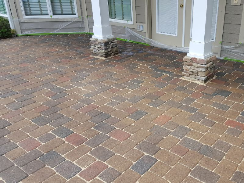 A freshly cleaned and re-sanded paver job at a residential property.