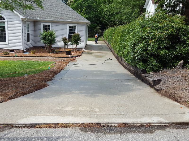 Putting the finishing touches on a huge driveway cleaning job.