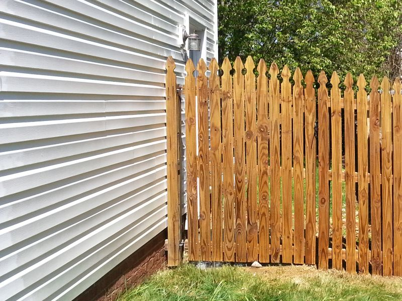A freshly cleaned wood fence with Precision.
