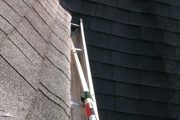 Getting every last speck out of the gutters before Raindrop gutter guards are installed.