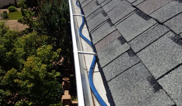 Before Raindrop gutter guards are installed on a homes gutter system.