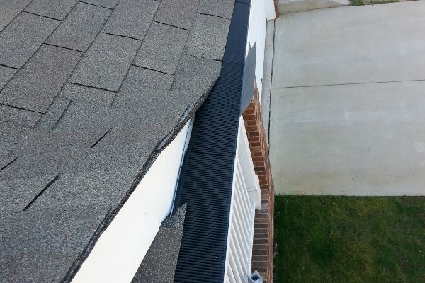 Custom fit Raindrop gutter guards on a home.