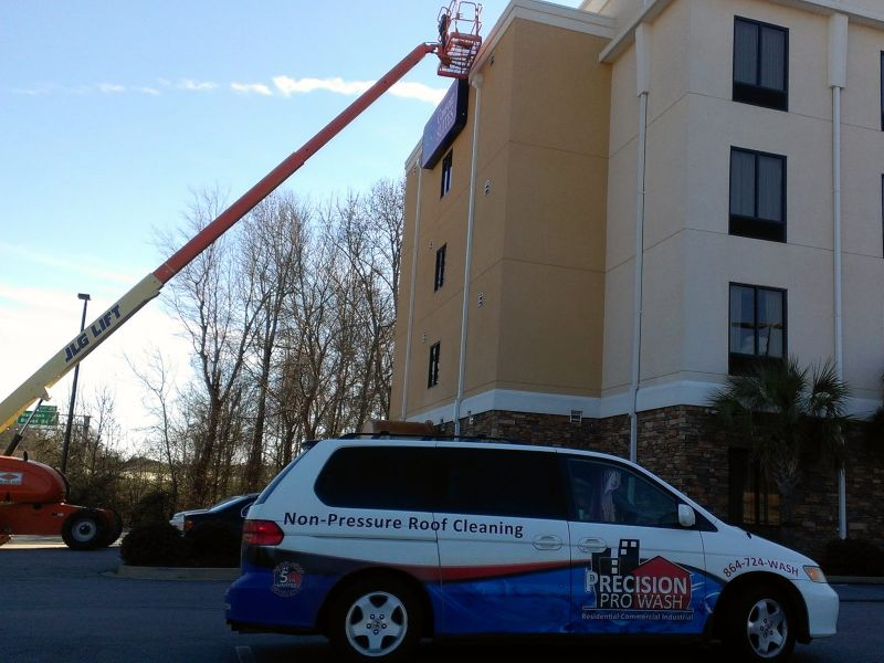The Precision Pro Wash Manager vehicle on a large hotel pressure washing job.