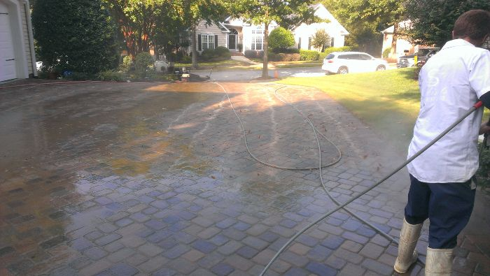 Driveway pressure washing during the service.