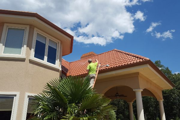 Outdoor roof washing on a beautiful day on a beautiful home.