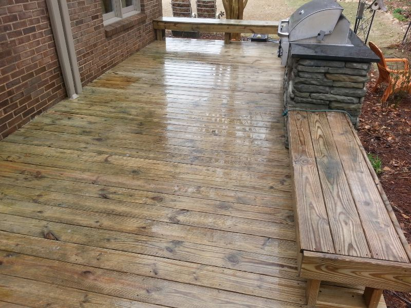 A freshly cleaned wood deck that's ready for a coat of stain.