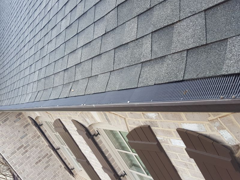 Raindrop gutter guards installed on a home.