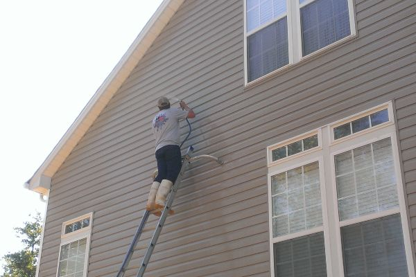 Up close look at how soft washing makes siding look like-new.