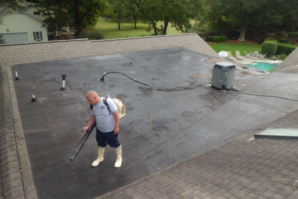 Prepping a roof to be cleaned.