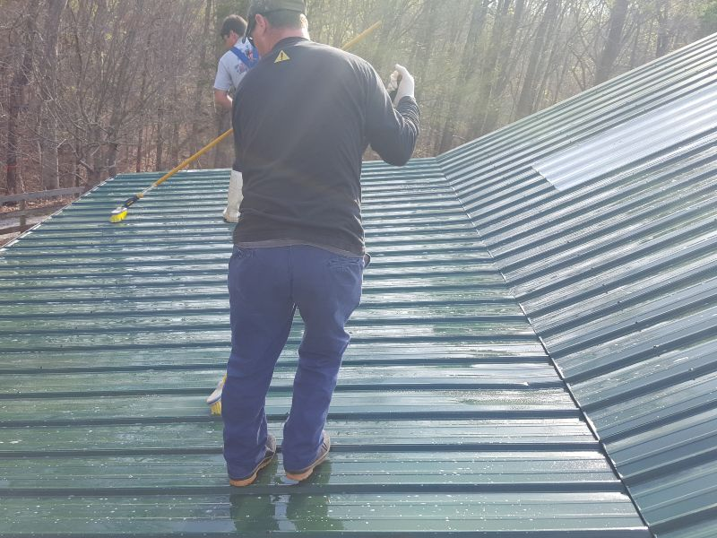Scrubbing a dirty roof.