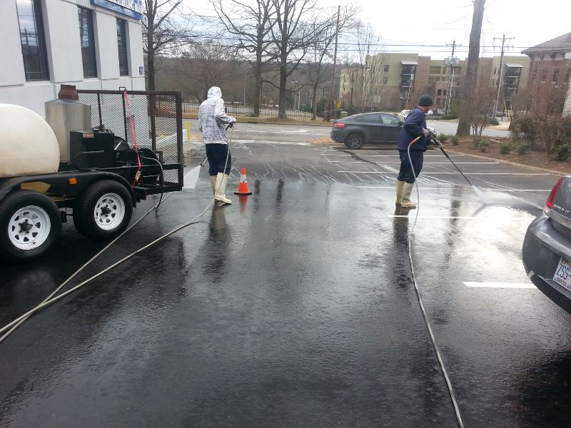 Commercial concrete cleaning on a parking lot.