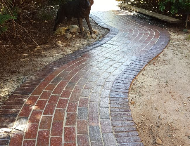 After concrete walkway cleaning and glossy sealing applications.