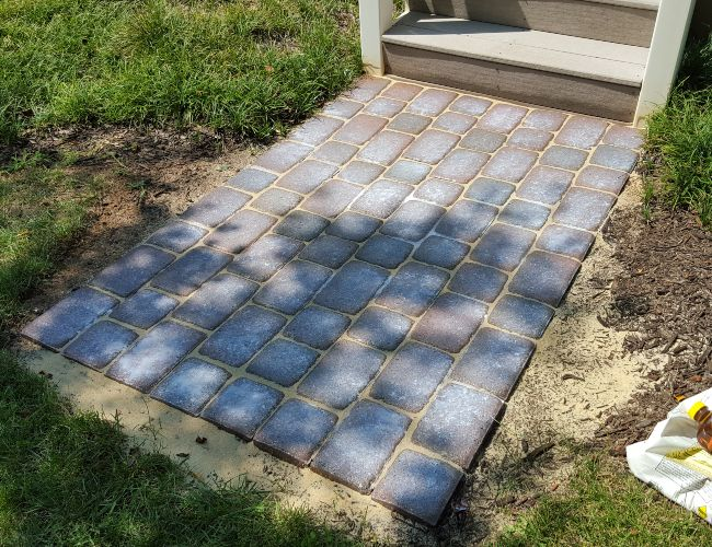 Re-sanding paver stones extends the life and protects your pavers for years.