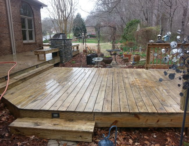 Wood deck cleaning during. Exterior cleaning at its finest.
