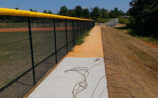 Stunning results on a baseball field pressure washing concrete.