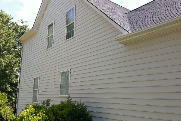 Restored siding after a soft house washing service.