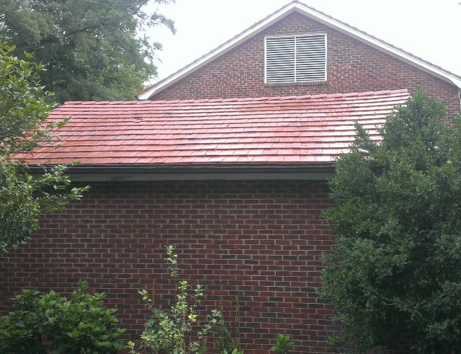 Stunning results after roof cleaning by Precision Pro Wash.