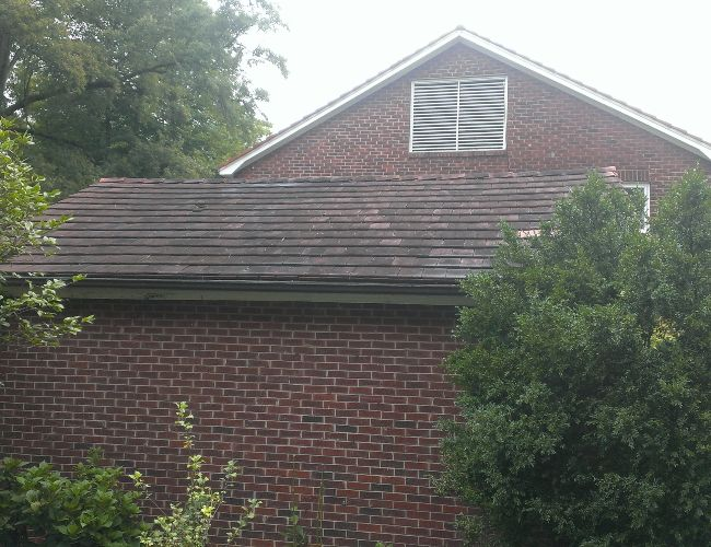 Does your roof look like this? Expert roof cleaning with Precision.