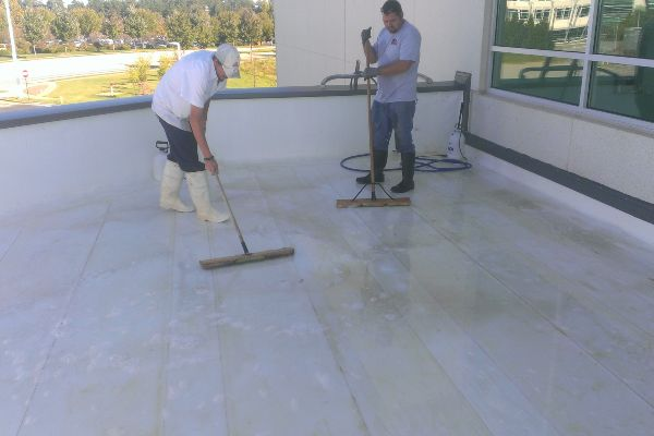 Putting the final prep work on a TPO roof before cleaning and sanitizing.