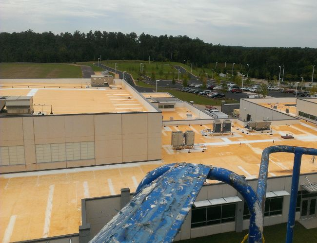 On the job site at a commercial roof washing project