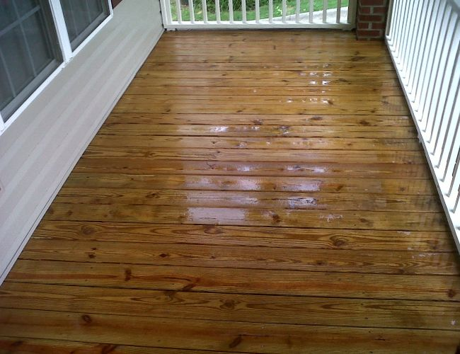 After deck cleaning, a fresh coat of sealer is applied to stay protected.