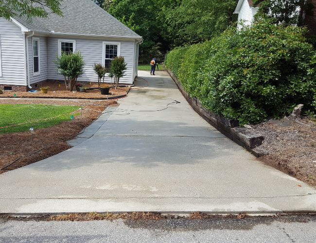 After a professional concrete driveway cleaning service.