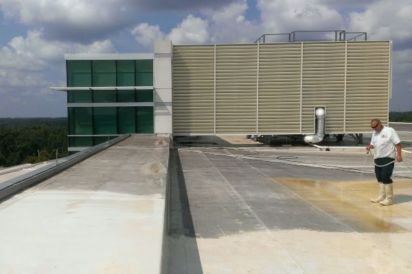 Prepping a TPO commercial roof for cleaning and sanitation.
